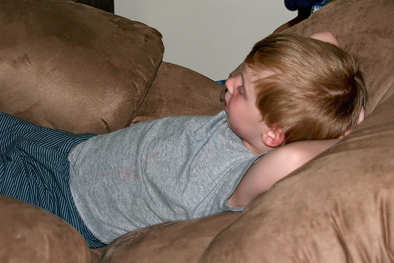 Relaxing while taking in a little tv before bed. He takes after Dad more every day.