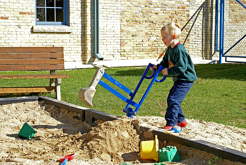 Playing with a cool digger toy.