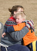 John taking a breather during soccer, and getting a hug from Mom.
