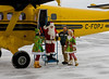 Santa Claus arrives at the Dryden airport via a MNR de Havilland DHC-6 Twin Otter, with his two elves.