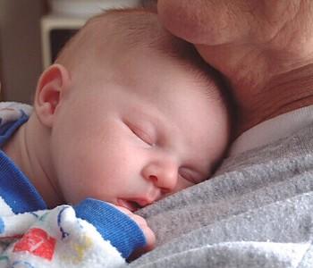 Asleep in Grandmas arms.