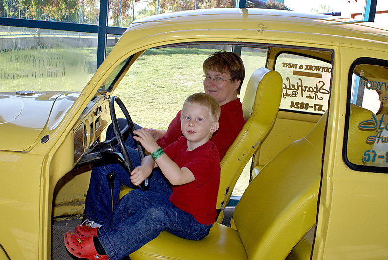 At the Childrens Museum.<br /> <br /> They had the shell of a Bug that you could get into and pretend to drive. John loved that!