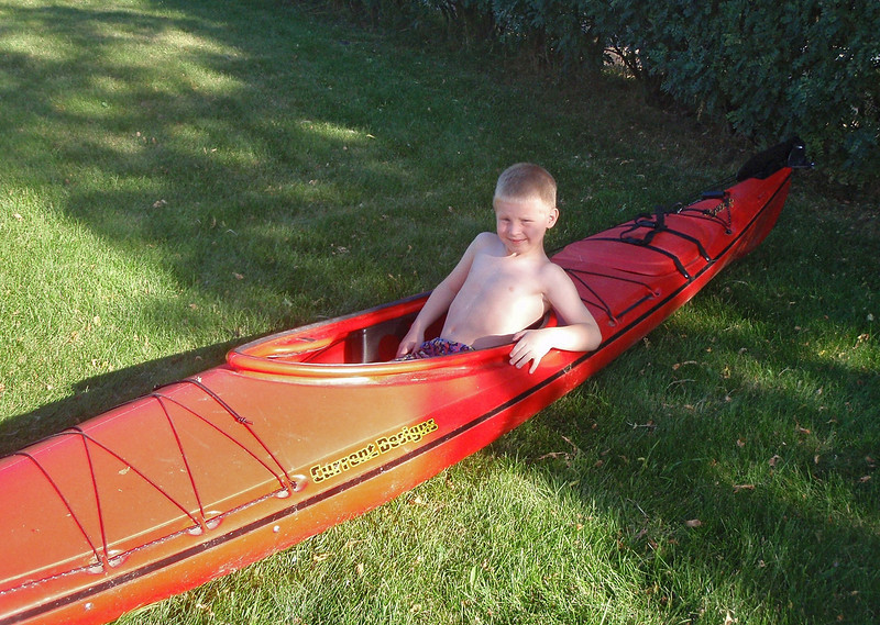 John just had to sit in my kayak for a bit. While sitting in it, he asked me to take his picture.