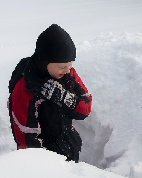 John outside playing in the snow. Here he is in a hole he dug next to the deck.