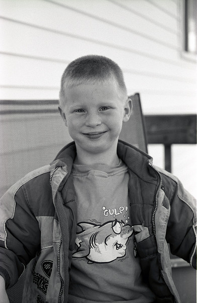 John on the deck. I grabbed him before he could go inside when he came home from school.<br /> <br /> Leica R4, bulk loaded T-max 100 developed in Kodak D76 for 10 mins at 19C.