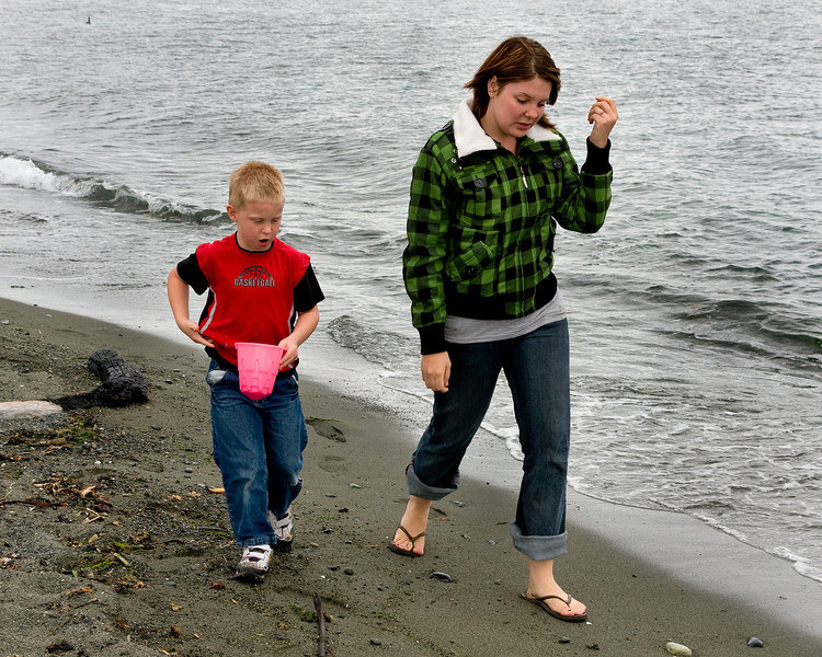 John and Kissanya walking on the beach in Victoria BC, looking for shells.