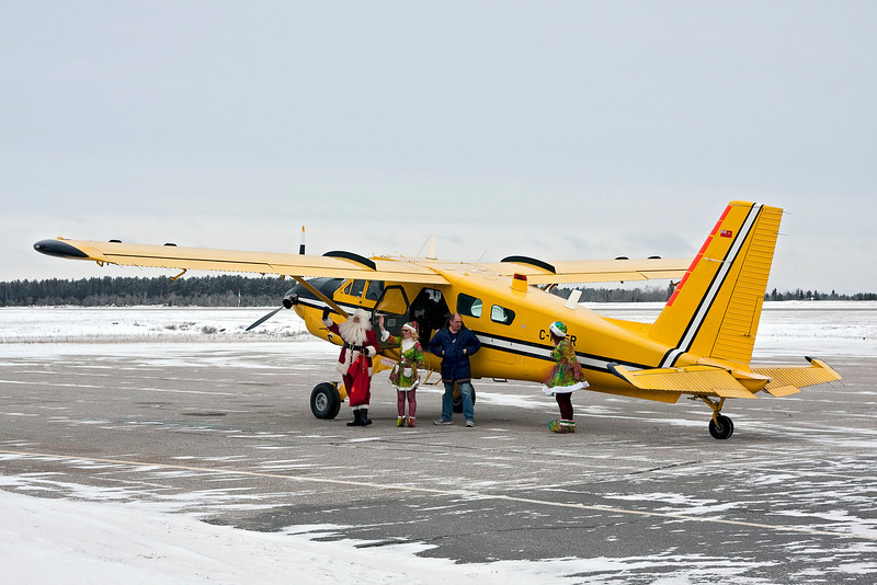 Santa arrives at the Dryden airport to spend the day with children from the local schools.