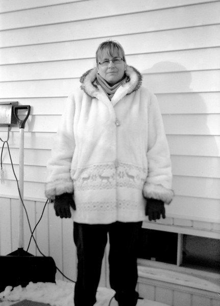 Wendy outside the house. I used a Kodak Monitor camera (circa 1940) that takes 620 film. I re-rolled some 120 film onto a 620 reel in order to use the camera. AS it doesn't have a built in meter, I had to use a hand held light meter to meter the scene.<br /> <br /> I also had to guess at the distance in order to set the focus. Seems the camera can't keep the focus plane straight as the bottom of the image is not as sharp as on top of the image but it might be from the way I was holding the camera. I cut off her feet as I wasn't sure how this camera worked as far as composing the image and I wanted to be sure to get her face in the photo.<br /> <br /> Shanghai GP3 120mm film developed in Kodak D76 1:1 for 15.5 minutes at 19C. First time I used this camera, and this film.