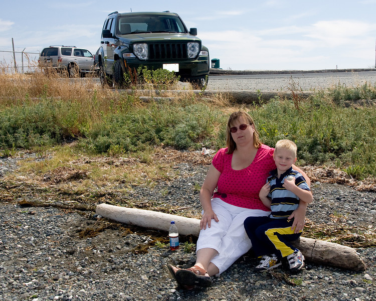 Family photo: John, Wendy - and the Jeep at the beach, Victoria, BC.
