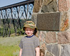 John in front of a monument of the CP Rail High Level Bridge in Lethbridge, Alberta.