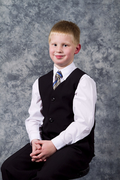 A photo I took of John in my home studio for his First Communion.