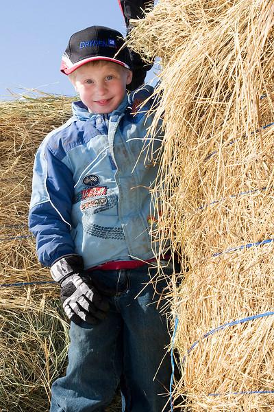 Here John is enjoying climbing on some hay bails.