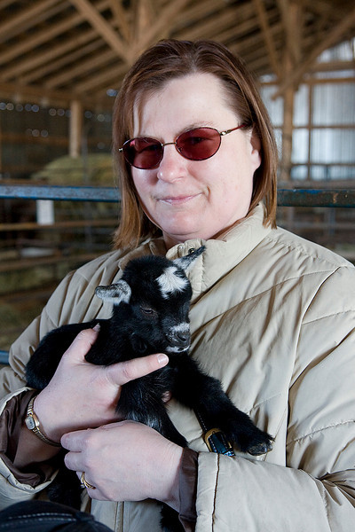 Wendy holding a baby goat.