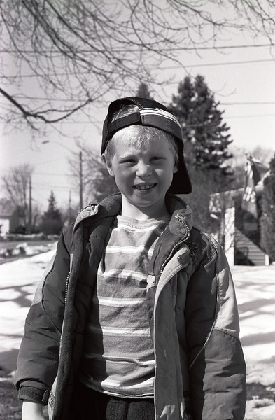 John on the front lawn. Photo taken with a Leica R4 loaded with hand rolled Kodak T-Max 100, self developed.