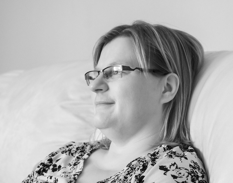 Wendy on the couch, window lit.<br /> <br /> Photo taken with a Canon 10D converted to shoot ir, with a Canon 50mm 1.8 II lens. 1/80 second hand held,    F3.5 and at ISO 800