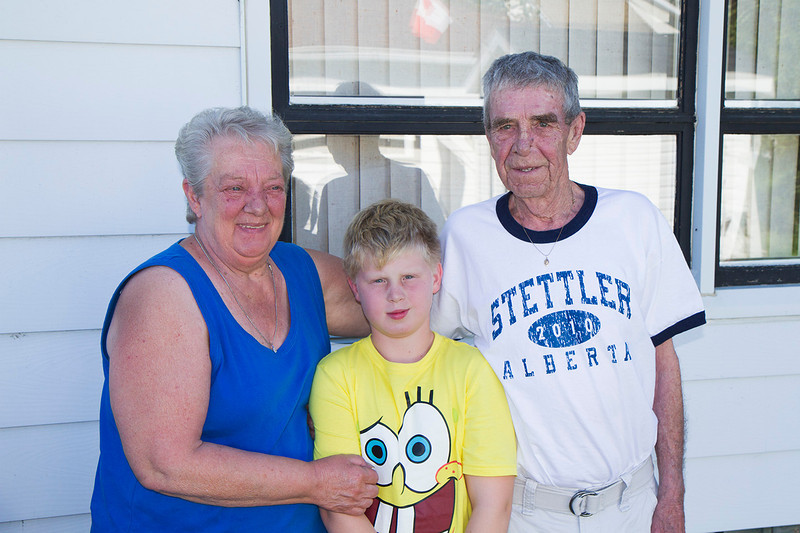 John with Grandma Memory and Grandpa Ed outside their house in Stettler Alberta, summer of 2012.