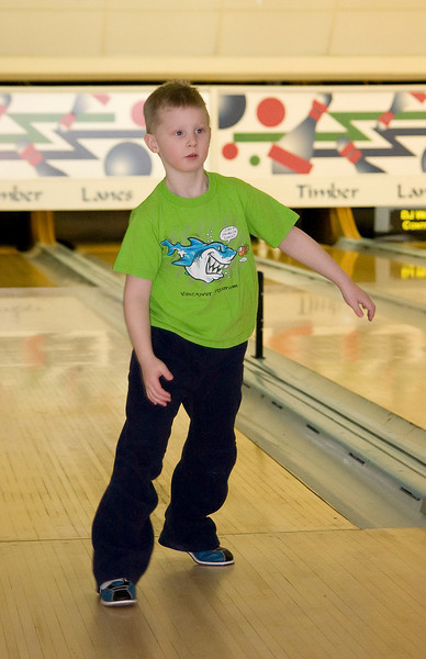John is on a youth bowling league. Here he is going for another bowling ball as he only knocked down a couple pins.