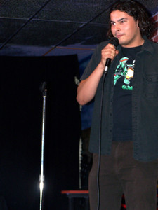Andrew does stand up at the Ha Ha Cafe. Andrew loses his comedy virginity.