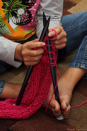 Amy knitting a scarf.  Love those feet!