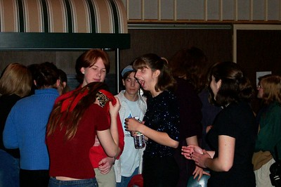 A bunch of folks (at least Lindsay, Joe, Kristie, Natalie, and Kaylyn) hanging around during intermission at Poet's Cafe, probably 2002?