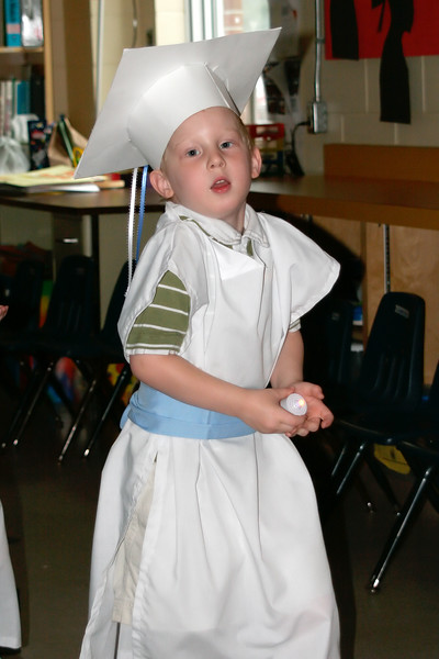 To start things off, the teacher had the children come in to the room in a line to the front of the room. They all wore the white robes with the boys using a blue sash and the girls a pink sash.