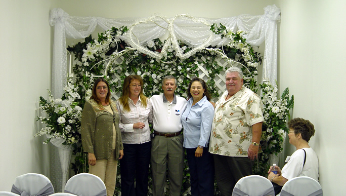 May, 2004  NO... Joe did NOT get married!!! Directly across from the meeting room was the casino Chapel. We just couldn't resist a Group Picture!