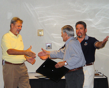 June, 2005  Joe getting an award from Jim Carroll. It makes a great story to say that he ignored Victor Rendon, the RVP, and Victor was upset. Truth of the matter is that the image just happened to catch the expressions.