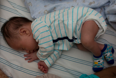April 30, 2015  Sleeping in this position reminds me of being in the womb; except for the diaper and socks of course.