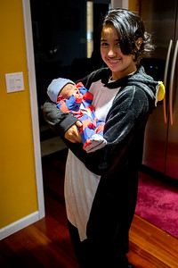 April 7, 2015. Michael isn't the only one who enjoys a onesie.  Is that a penguin onesie big sister?