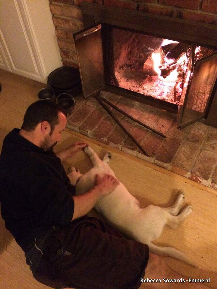Romantic spooning in front of the fire.