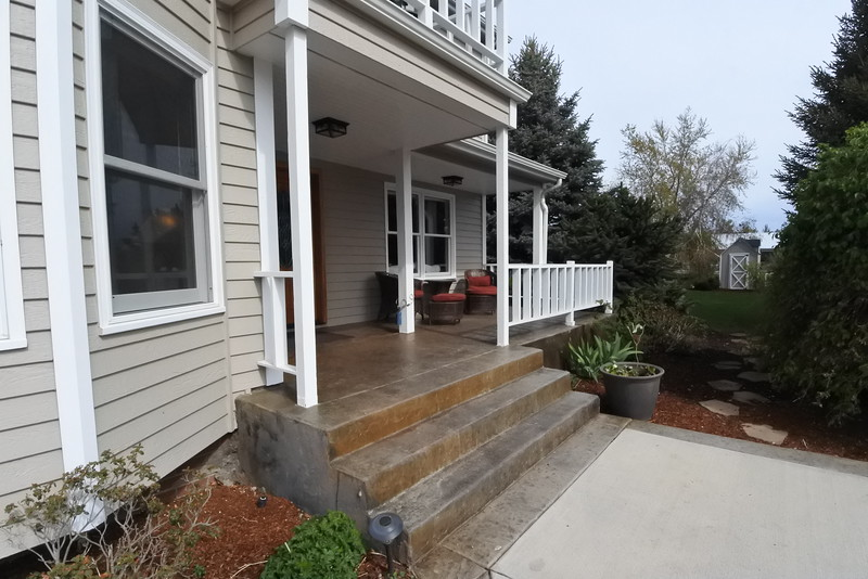 Front Porch and cobblestone walkway to the pond