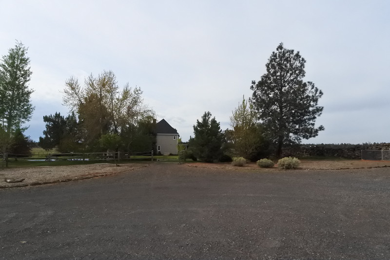 This looks back at the house and pond area from the barn and shop area.
