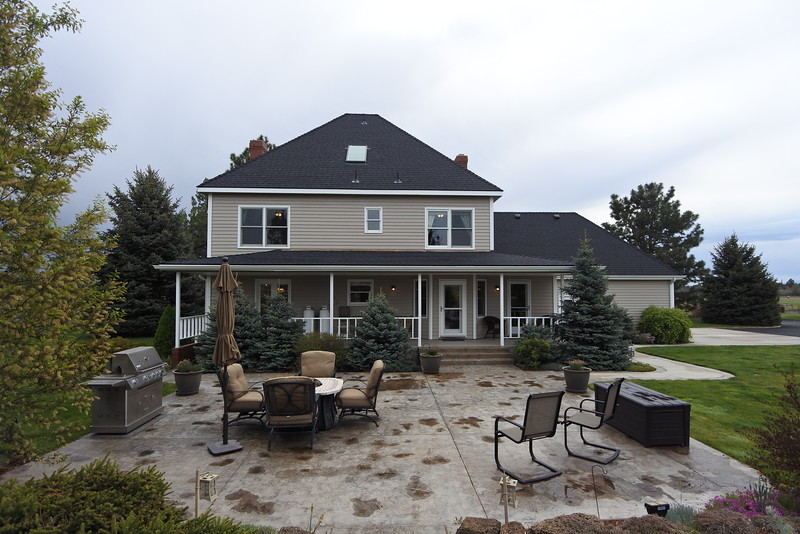 The west facing side of the house and the patio