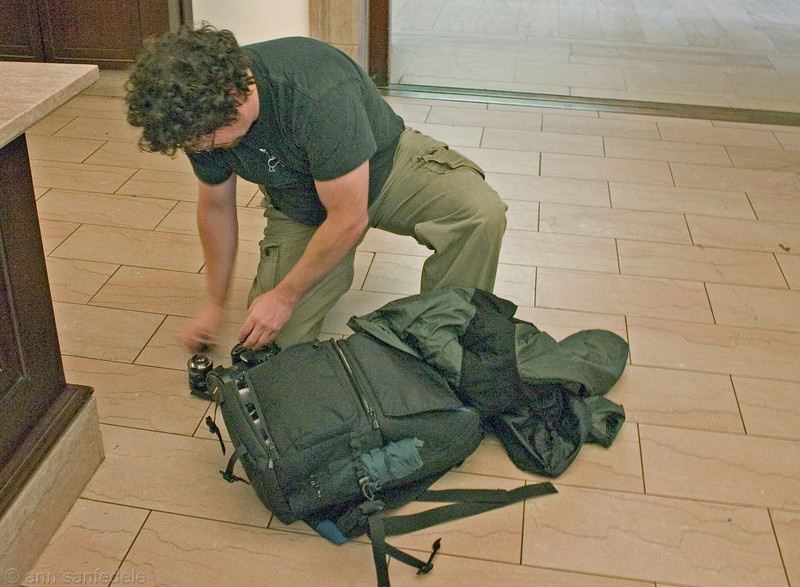 Larry prepares to check his gear bag so they will let him in the Art Institute in Chicago.
