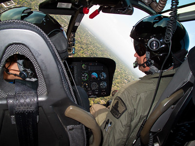 """We mostly turn left."" This is a typical view from inside the Sheriff's Dept. helicopter when on the job. Since the Tactical Flight Officer sits on the left side, most orbits are to the left so he can see better."