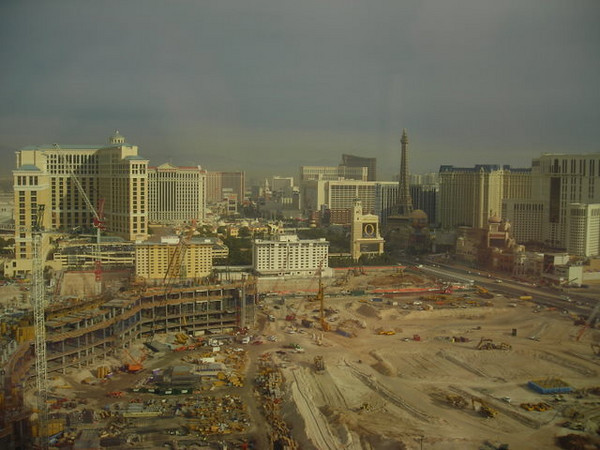 Our main view was the big construction pit where the Boardwalk used to be.<br /> <br /> Beyond the construction we had a view of the Bellagio and fountains, as well as Paris all lit up at night.