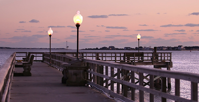 On the last day of our trip to the beach, Tammy, Jeff, Caleb, Michelle and I drove up to Wilmington to see what was there.   We visited UNCW, downtown Wilmington, and of course a bunch of bookstores.   On the way back to Myrtle Beach we stopped at Southport's City Pier and took some photos.   Here is the pier just as darkness was setting in for the night.
