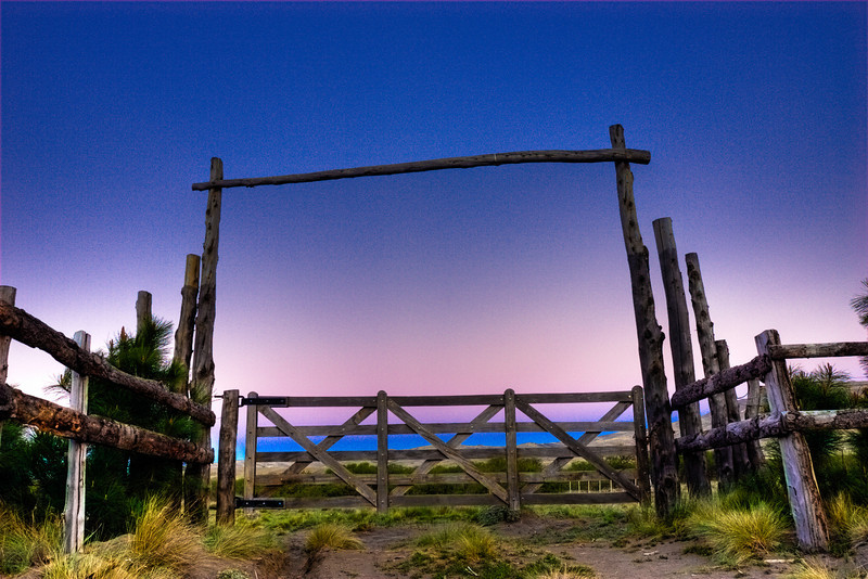 Entrance to an estancia (ranch) at sunset