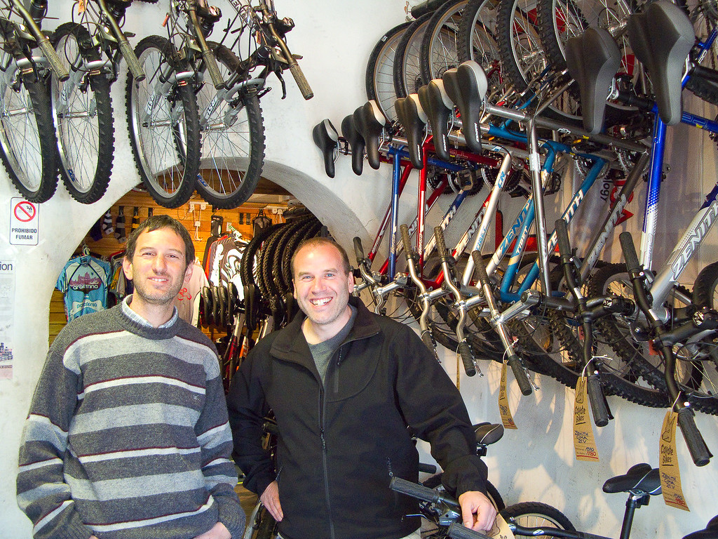 Dale and his friend Coyote at his bike shop in Esquel, Argentina