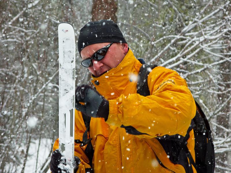 Chuck waxes his skis