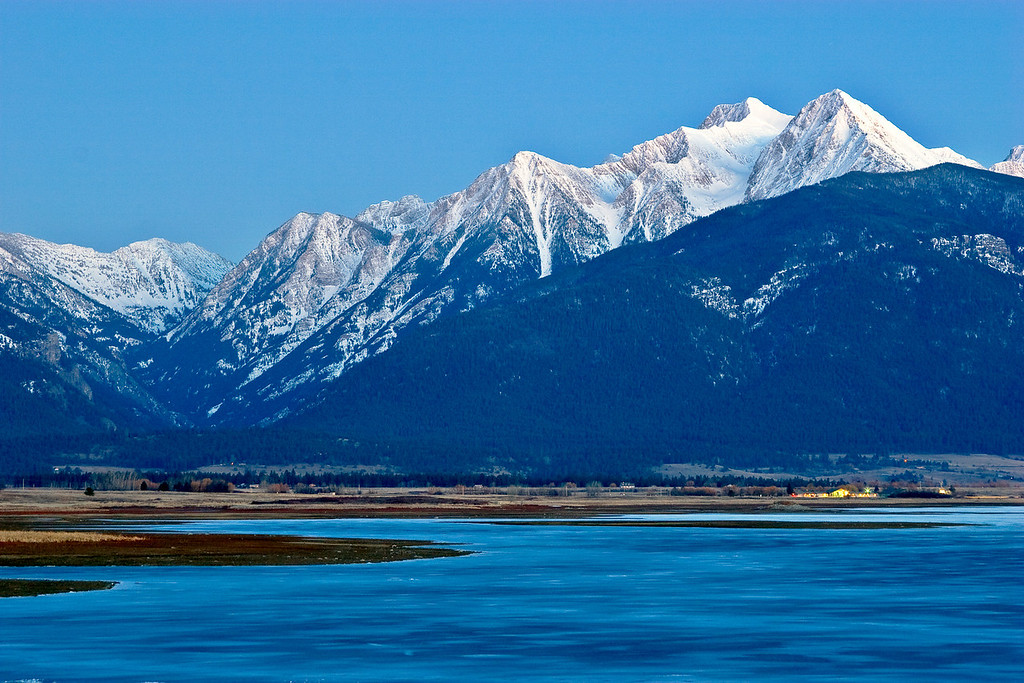 The Mission Mountains and frozen lake photographed from Ninepipes National Wildlife Refuge - Montana