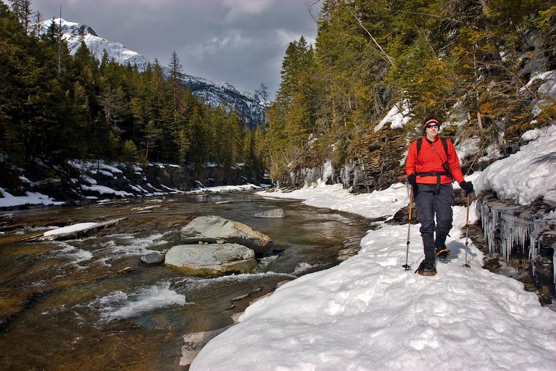 Mona snowshoeing next to McDonald Creek, Glacier National Park