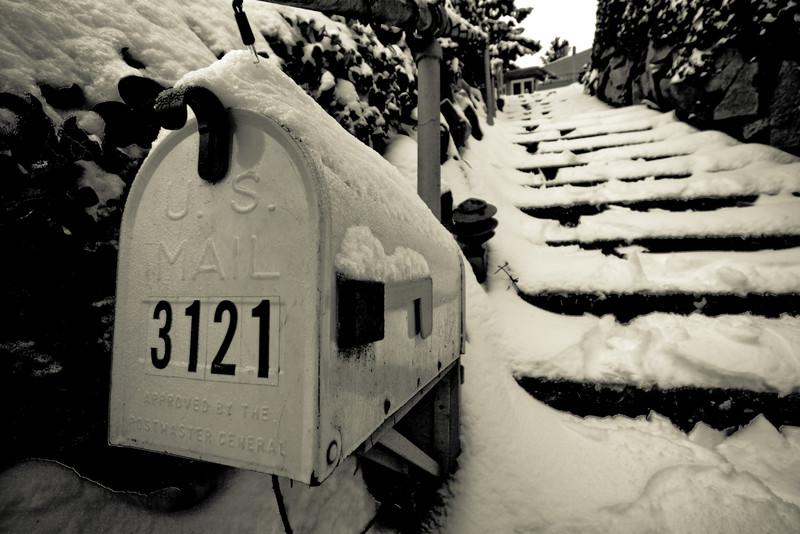 Snow covers a mailbox in residential Seattle