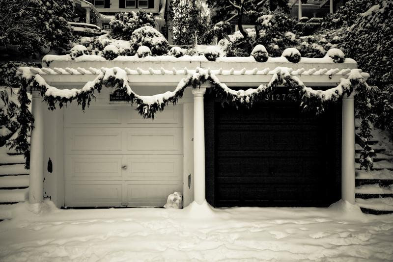Garages decorated for Christmas unexpectedly covered by snow