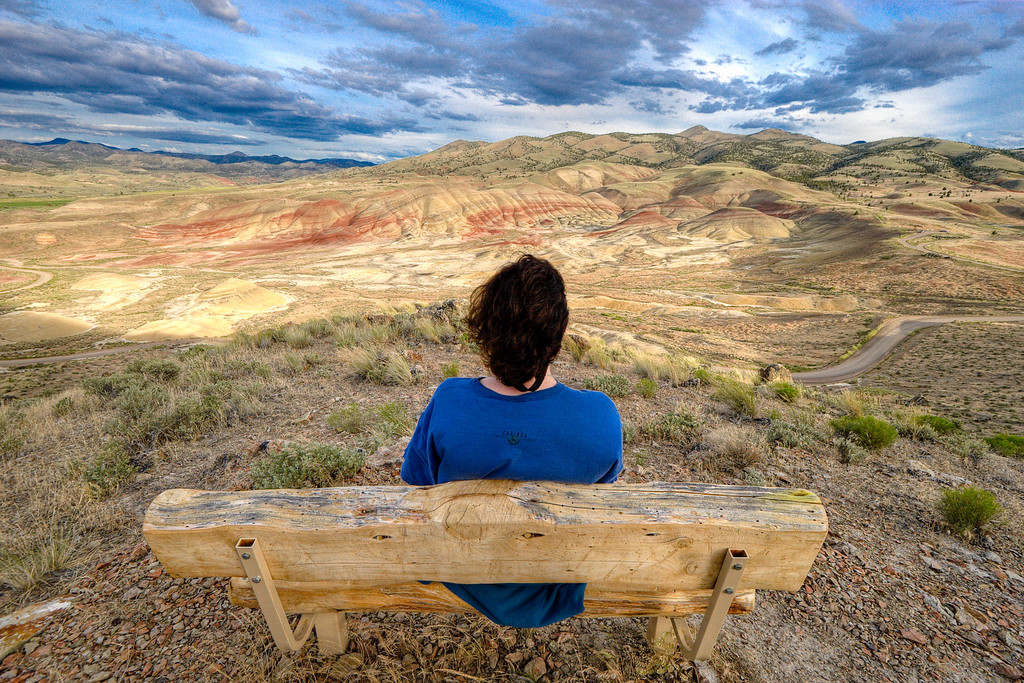 Mona looking out at the panoramic Painted Hills - John Day Fossil Beds, Oregon