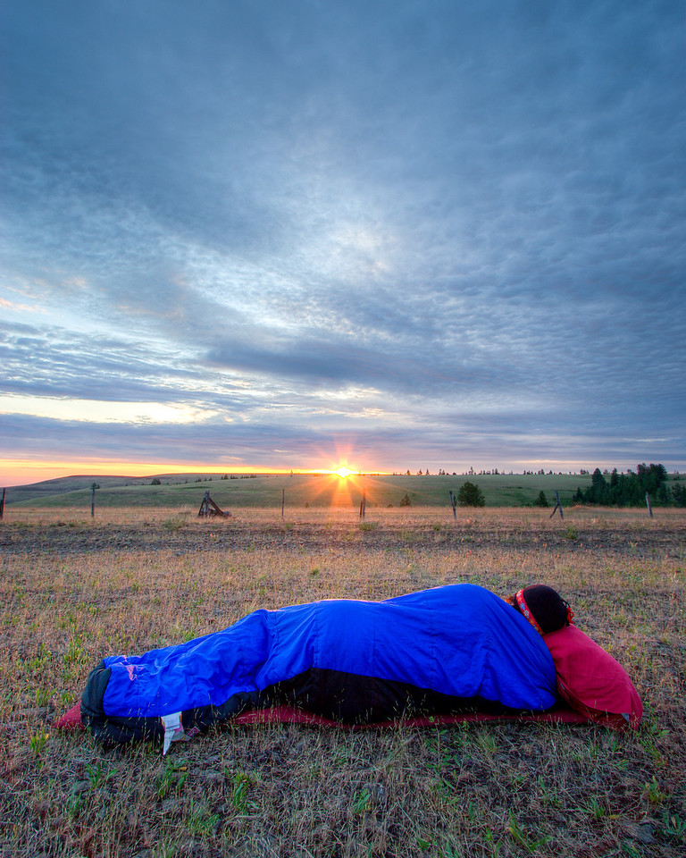 Mona watching sunrise from her sleeping bag