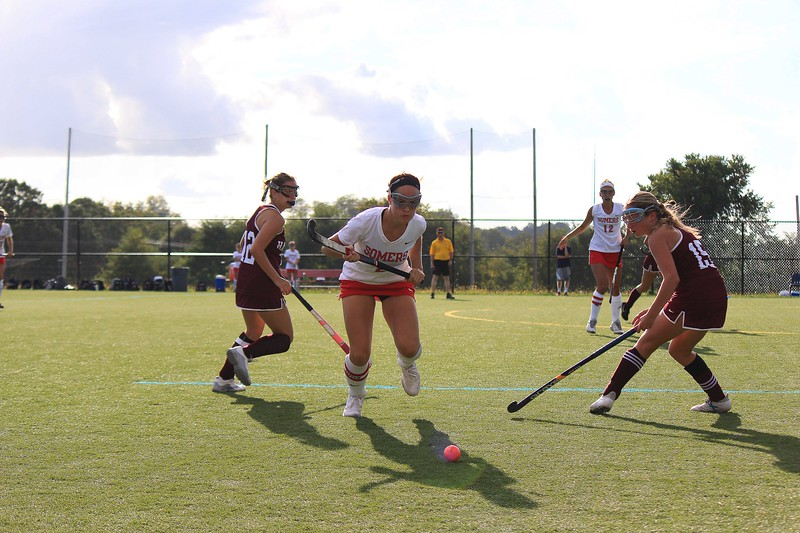Sheridan Devito rushing to recover the ball from Harrsion