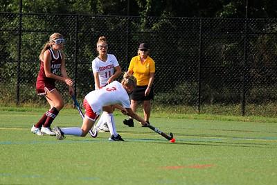 Caitlin Spor passing the ball to teamate Rosealie Murphy