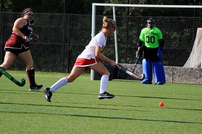 Caitlin Spor moving the ball towards the goal
