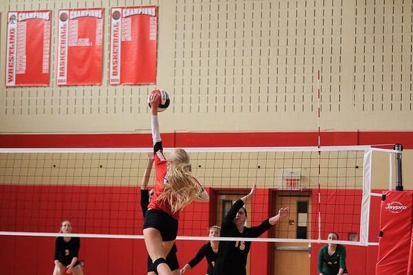Chloe Pittman spiking the ball over the net